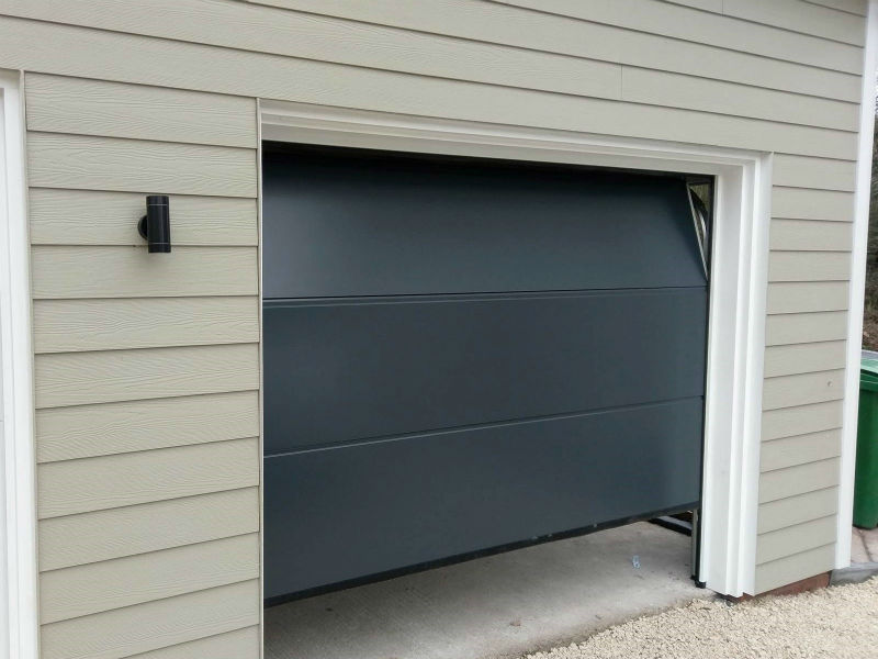 Alutech Trend insulated sectional in large rib in smooth Anthracite Grey in Nesscliffe