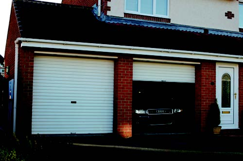 two Gliderol non insulated roller doors in white