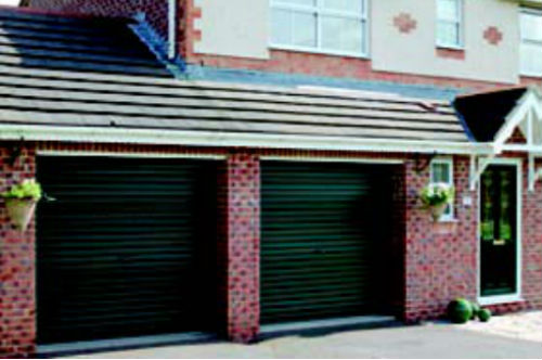 Two Green Gliderol non insulated roller doors