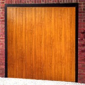 Cardale Elite Vertical-Rib ABS garage door in Golden Oak