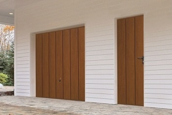 Hormann Wide Vertical-Rib Up & Over garage door in Golden Oak with matching side door