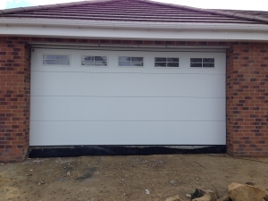 Carteck Solid Smooth Insulated sectional garage door