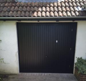 Cedar Door Bakewell up and over door with wicket