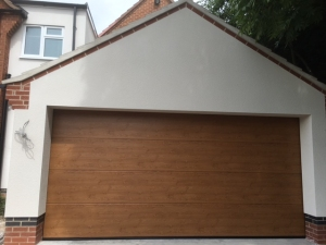 Hormann Insulated L-Rib Steel sectional garage door in Winchester Oak