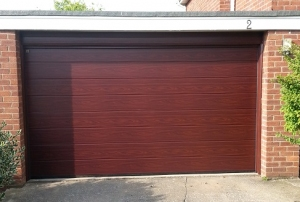 Hormann M-Rib Insulated Steel sectional garage door in Rosewood