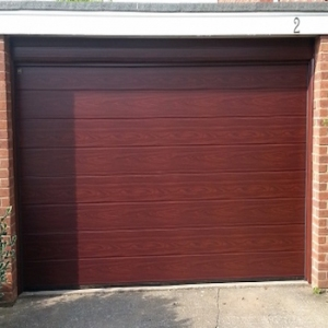 Hormann LPU42 M-Ribbed Decograin Sectional Door in Golden Oak