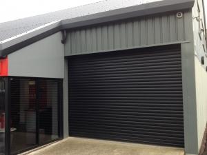 E: Aluroll i95 steel light industrial roller shutter door in Black