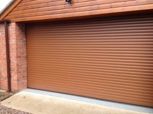 G: Aluroll Classic insulated roller shutter in Golden Oak effect