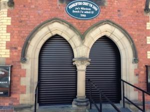 F: Aluroll Classic roller shutters in Black fitted in a Welsh Methodist Chapel