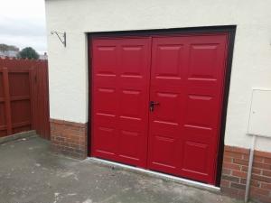 A: Garador steel Georgian panel side-hinged doors in Ruby Red