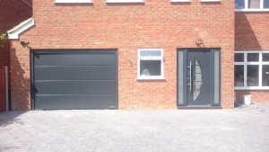 D: Hormann LPU42 insulated sectional and Thermo46 TPS 900 front entrance door and side elements all in Anthracite Grey