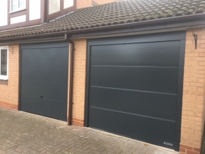 B: Hormann LPU42 insulated sectional in L rib and Garador Design 100 up & over doors in Anthracite Grey