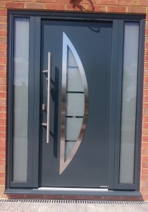 F1: Hormann Thermo46 TPS 900 front entrance door in Anthracite Grey with glazed side elements