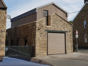 A: Hormann N500 style 405 open for infill up and over garage door, clad in pre-coated cedar, project partly funded by European Fund for Rural Development