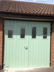 C: CarTeck GSW 40-L insulated side-hinged garage door set in small vertical rib in smooth finish in Chartwell Green with vertical windows