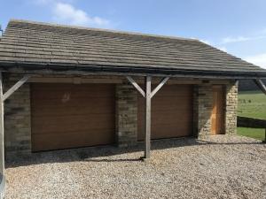C: Hormann LPU 42 sectional doors in medium rib in Winchester Oak