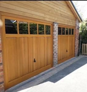 D: Pair of Woodrite Padbury up and over garage doors in Light Oak finish