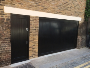 A: Woodrite Barnham up and over garage door and personnel door in accoya in Black 70% gloss finish as stipulated by RBKC