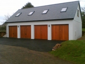 Four matching solid cedar garage doors.